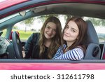 a woman driver who is happy to... | Shutterstock . vector #312611798