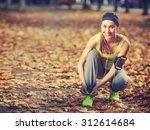running woman. runner is tying... | Shutterstock . vector #312614684