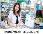 young female pharmacist picking ... | Shutterstock . vector #312632978