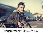 attractive young man in urban... | Shutterstock . vector #312675353