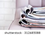 stack of magazines on chair ... | Shutterstock . vector #312685088