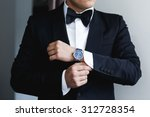 the groom puts on a watch | Shutterstock . vector #312728354