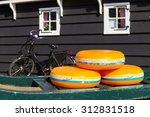 Dutch Cheese Wheels On A Green...