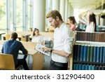 young man in the library | Shutterstock . vector #312904400