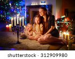 young mother and her two little ... | Shutterstock . vector #312909980