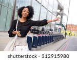 young office girl hailing a taxi | Shutterstock . vector #312915980