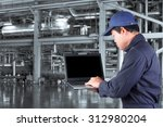 mechanic working on a computer... | Shutterstock . vector #312980204