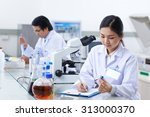 laboratory assistant filling... | Shutterstock . vector #313000370