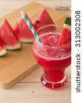 watermelon smoothie on wood... | Shutterstock . vector #313002308
