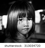 Little Girl Staring At The...