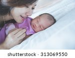 a portrait of a young mother... | Shutterstock . vector #313069550