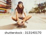 girl sitting on a skateboard | Shutterstock . vector #313140170