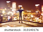 happy man faces skyline at night | Shutterstock . vector #313140176