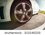 sportscar on a country road | Shutterstock . vector #313140233