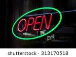 an open sign in a shop. | Shutterstock . vector #313170518