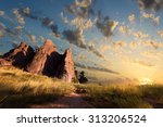 Stock photo dawn over red rocks and grass fields in boulder co 313206524