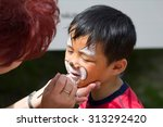 Little Boy Lets Painting His...
