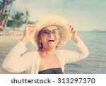happy mature woman of 50 years... | Shutterstock . vector #313297370