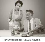 1950s beautiful woman serving... | Shutterstock . vector #313378256