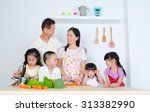 asian family in the kitchen | Shutterstock . vector #313382990