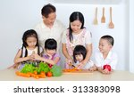 asian family in the kitchen | Shutterstock . vector #313383098