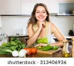 happy housewife with pan and... | Shutterstock . vector #313406936