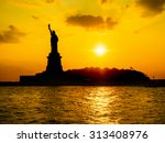 The Statue Of Liberty At Sunse...