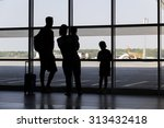 Silhouette Family At Airport I...