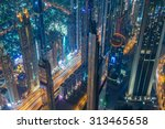 panorama of night dubai during... | Shutterstock . vector #313465658