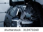 Satisfied Car Theft Seating on a Freshly Stolen Car. - stock photo
