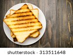 The Toast On Wooden Background...