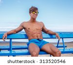 smiling muscular cuy in blue... | Shutterstock . vector #313520546