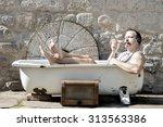 Man In The Bathtub Smoking A...