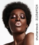 Small photo of black woman with a short afra and bright lips