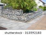 gabions in the garden | Shutterstock . vector #313592183