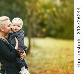 young mother and lovely kid boy ... | Shutterstock . vector #313726244
