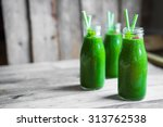 fresh green smoothie on rustic... | Shutterstock . vector #313762538