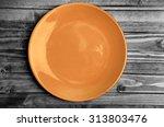 Empty Orange Plate On Gray...