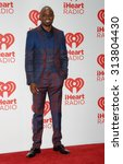 Small photo of LOS ANGELES - OCT 4: Wayne Brady arrives at the iHeartRadio Music Festival Day 2 on September 21, 2013 in Las Vegas, NV