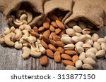 healthy mix nuts on wooden... | Shutterstock . vector #313877150