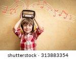 kid listen music at home.... | Shutterstock . vector #313883354