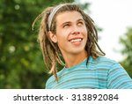 young man with dreadlocks... | Shutterstock . vector #313892084