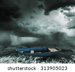 Old Boat In The Stormy Ocean