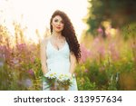 beautiful girl in the field ... | Shutterstock . vector #313957634