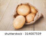 organic raw potato in sack bag... | Shutterstock . vector #314007539