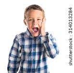 kid doing surprise gesture  | Shutterstock . vector #314013284