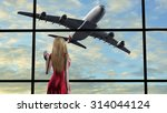 woman at the airport at... | Shutterstock . vector #314044124