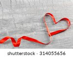 red heart ribbon on grey... | Shutterstock . vector #314055656