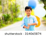 Small photo of smile boy with color-ful balloons