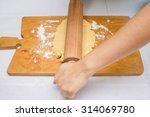 making dough on cutting board | Shutterstock . vector #314069780
